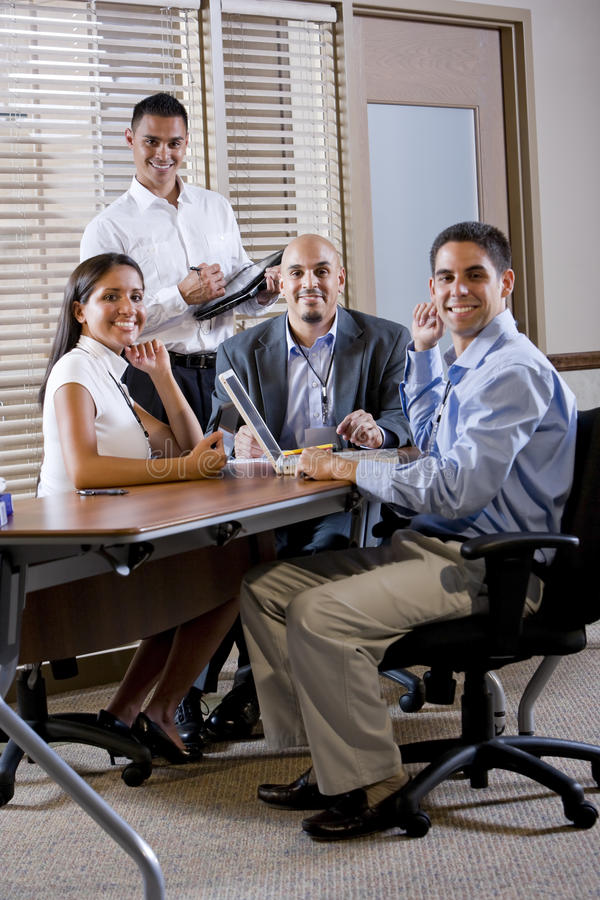 Happy office workers meeting at table in boardroom. Working together stock photos