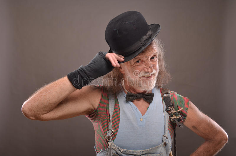 Happy old beggar stock images