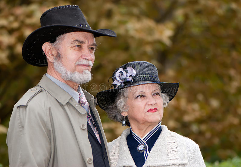 Happy Old Coule In Autumnal Park Stock Images