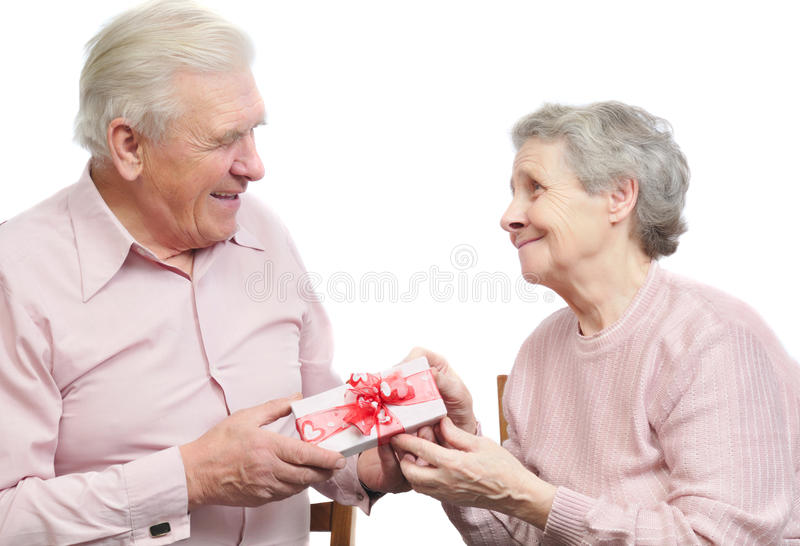 Happy old couple and box with gift royalty free stock photo