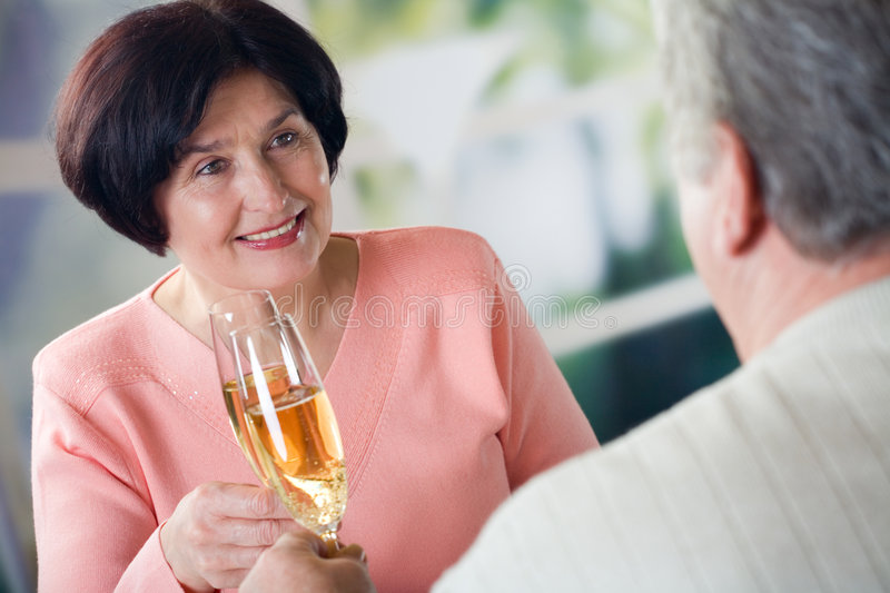 A happy old couple celebrating life event together royalty free stock photo