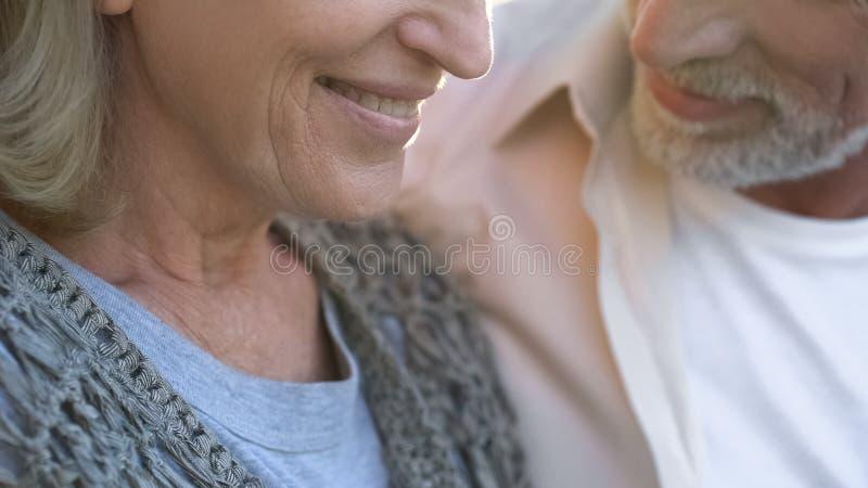 Happy old couple on date, female smiling close up, dental care, prosthetics royalty free stock image