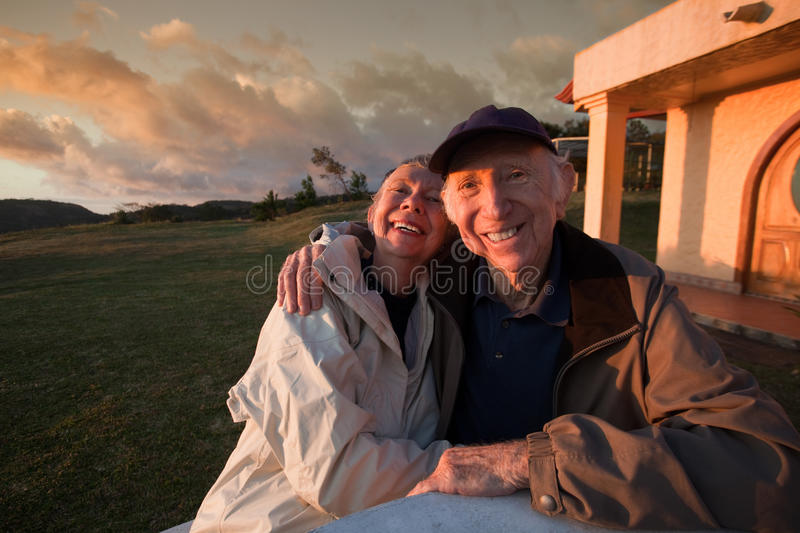 Happy Old Couple in Mountains royalty free stock photos