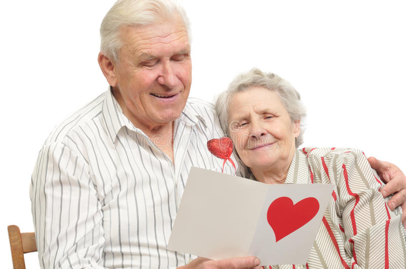 Happy old couple with post-card royalty free stock photos