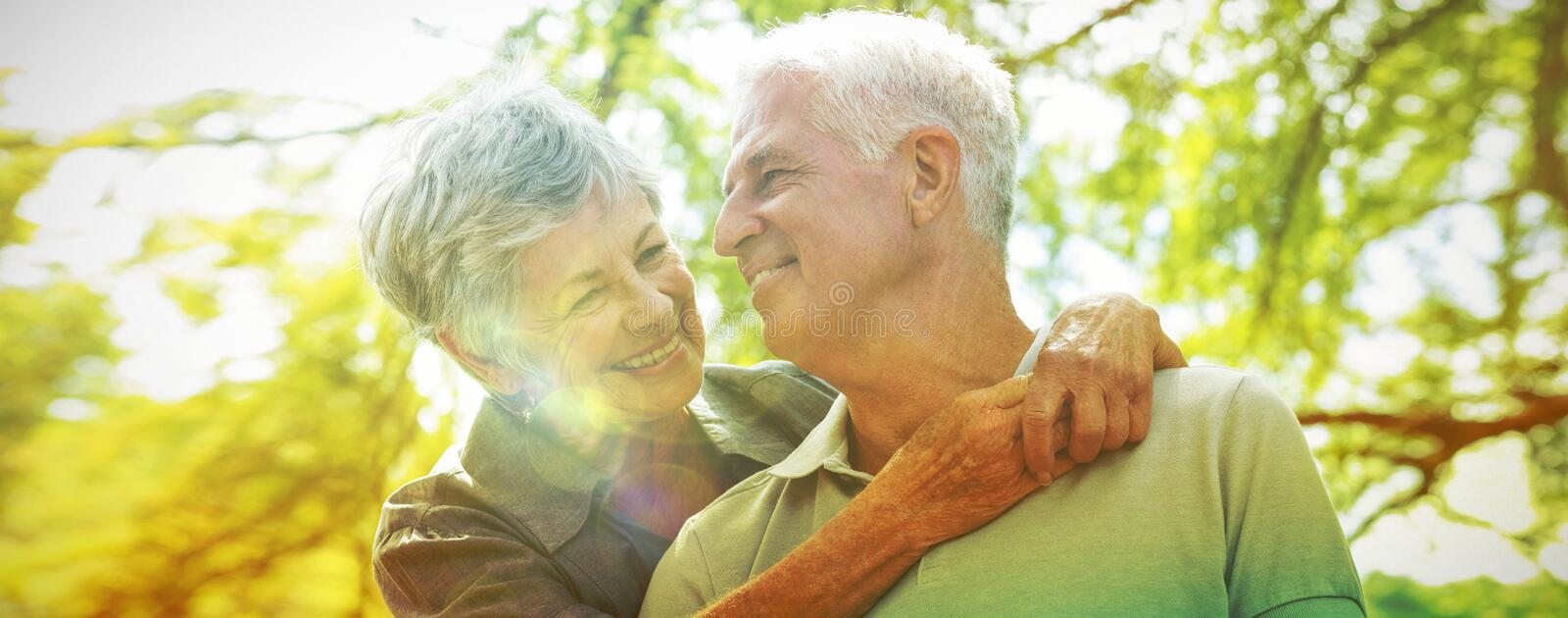 Happy old couple smiling stock images
