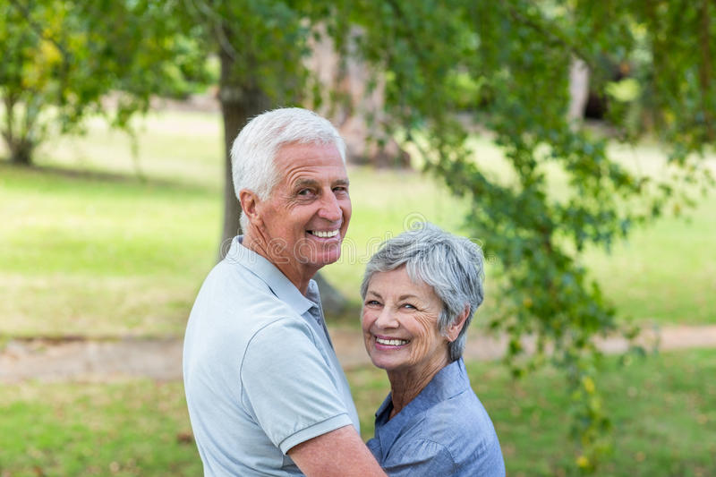 Happy old couple smiling stock photography