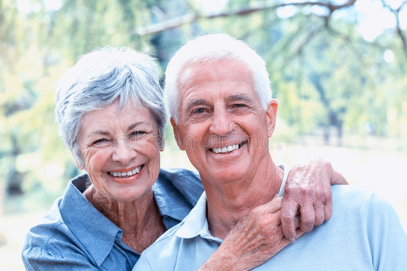 Happy old couple smiling stock image