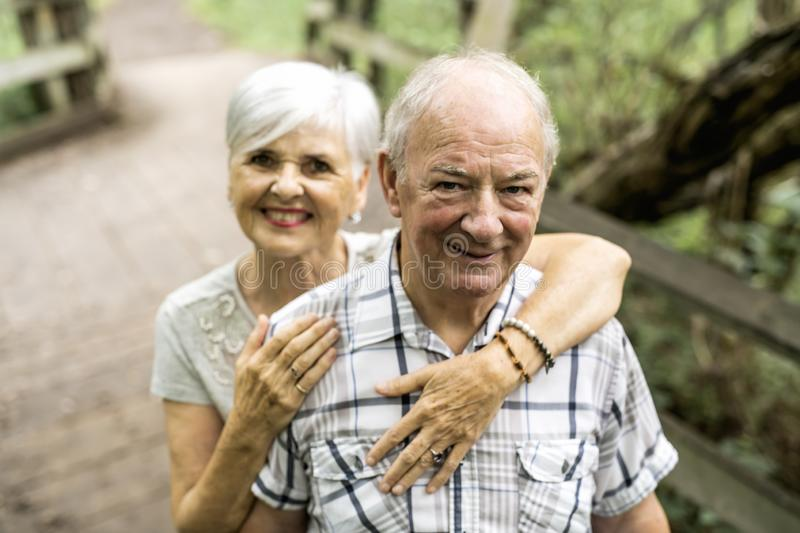 Happy old elderly caucasian couple in a park royalty free stock photo