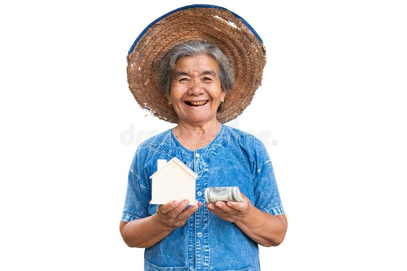 Happy old farmer woman holding little wood house stock images