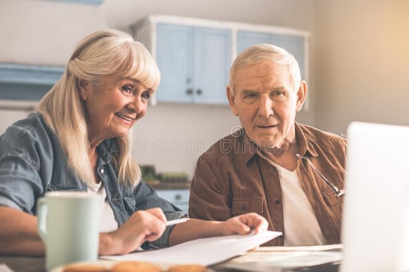 Happy old man and woman planning retirement with computer stock photo
