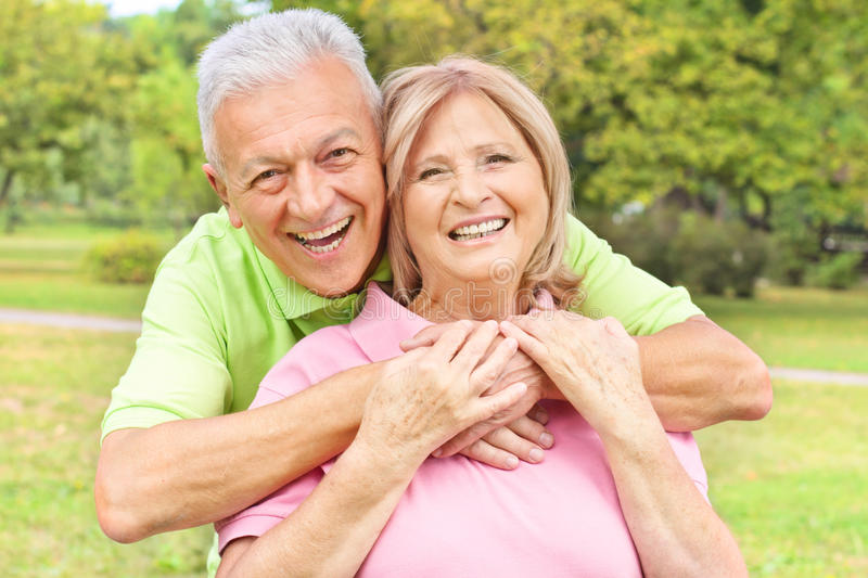 Happy old people outdoors royalty free stock photography