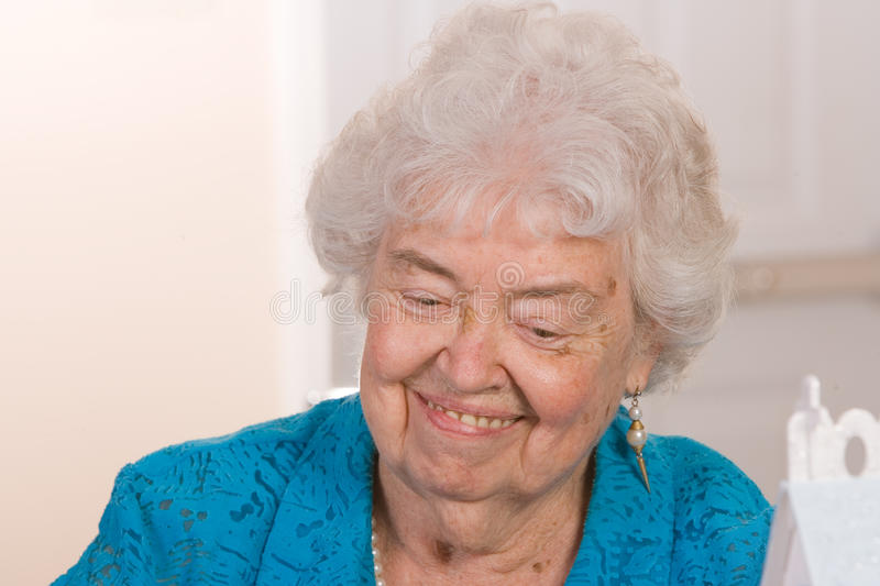 Happy old woman. Portrait of a friendly and happy old woman royalty free stock images