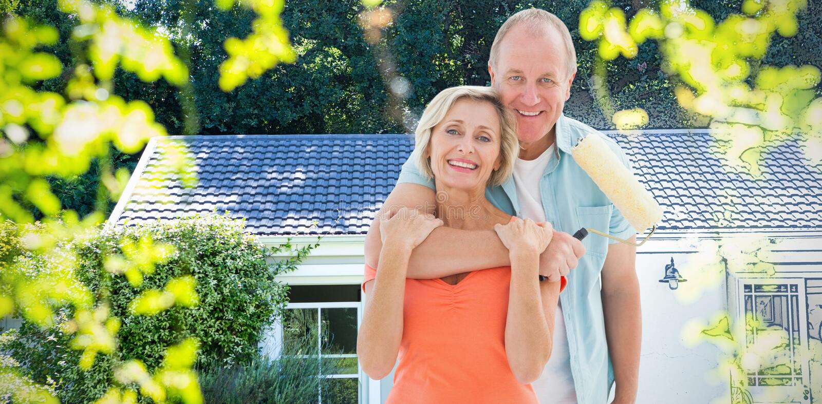 Composite image of happy older couple holding paint roller. Happy older couple holding paint roller against pretty house with a blue and white filter stock photo