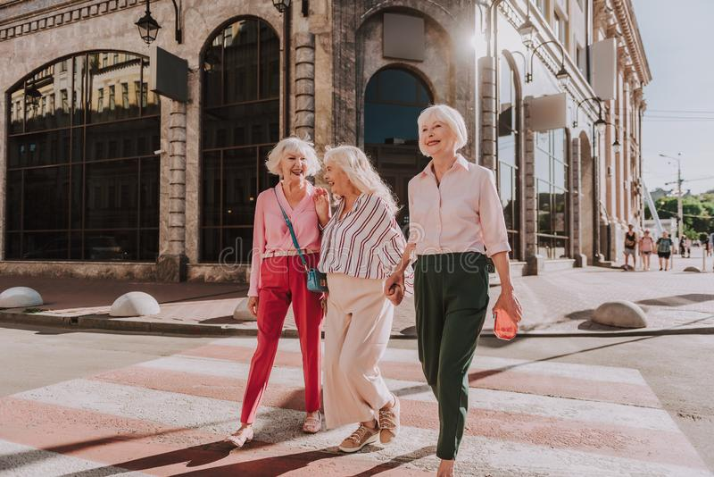 Happy older ladies are having fun together royalty free stock images