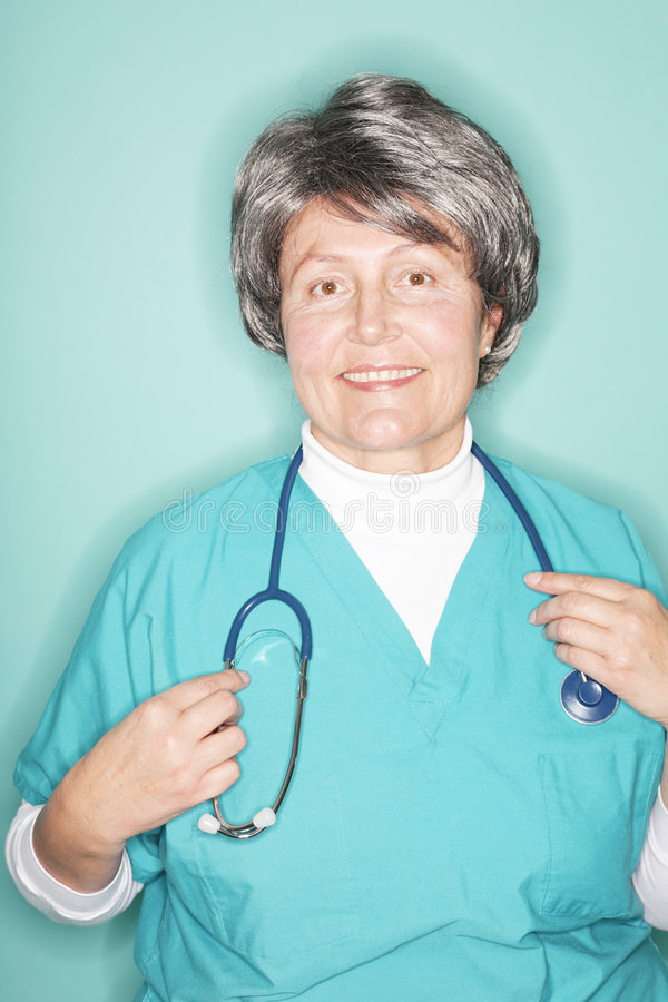 Happy older nurse stock photo