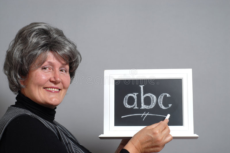 Happy older teacher royalty free stock images