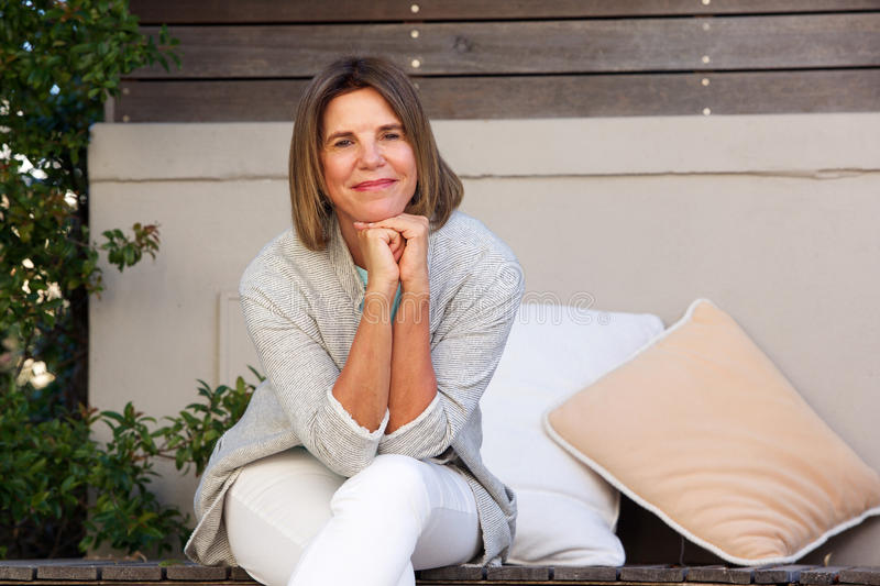 Happy older woman relaxing outside royalty free stock image