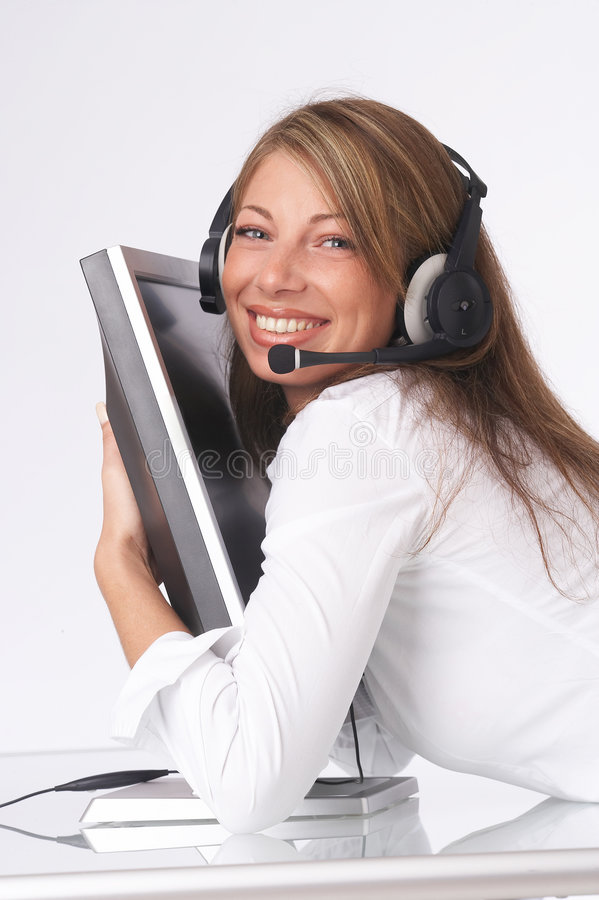 Happy operator. Pretty operator hugging monitor happily stock photo