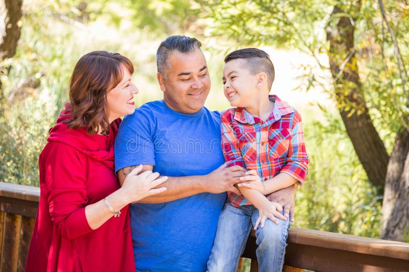 Mixed Race Caucasian and Hispanic Family on a Bridge. Happy Outdoorsy Mixed Race Caucasian and Hispanic Family Outdoors on a Bridge royalty free stock images