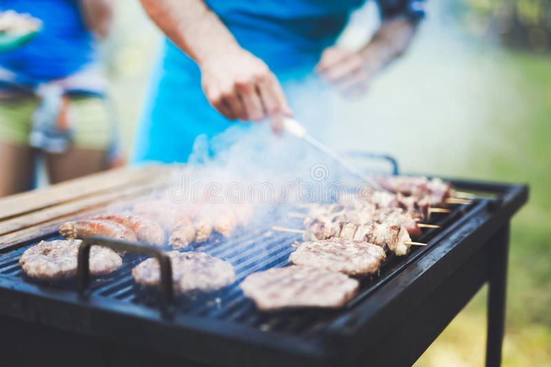 Happy outgoing people enjoying bbq stock photo