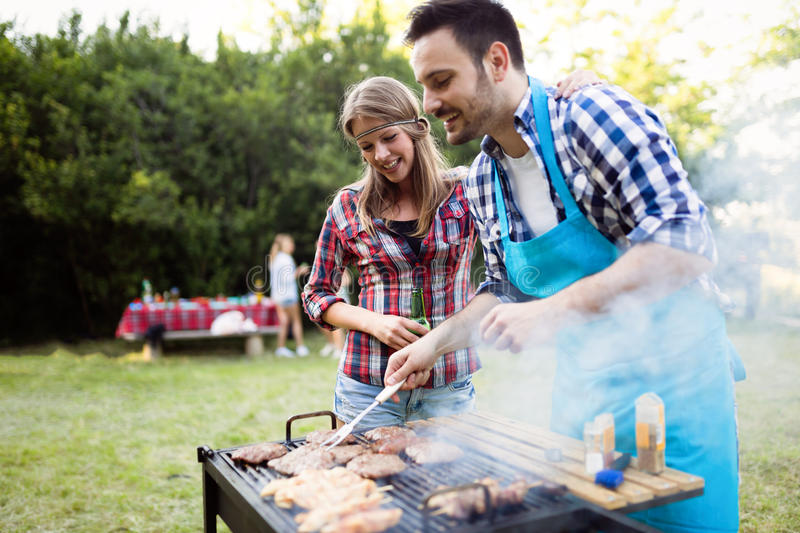 Happy outgoing people enjoying bbq stock image