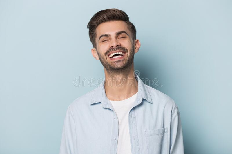 Happy overjoyed millennial man head shot studio portrait. royalty free stock images