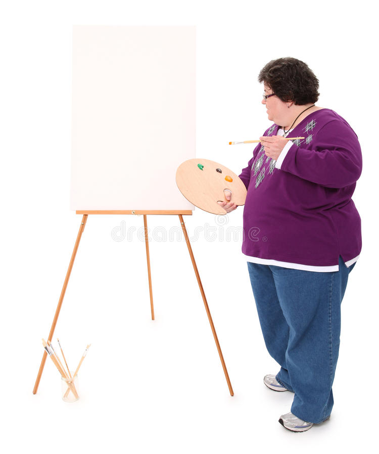 Happy Overwieght Forty Year Old Woman Painting royalty free stock photography