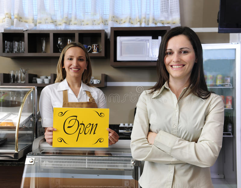 Download Happy Owner Of A Cafe Showing Open Sign Stock Photo - Image: 16600682