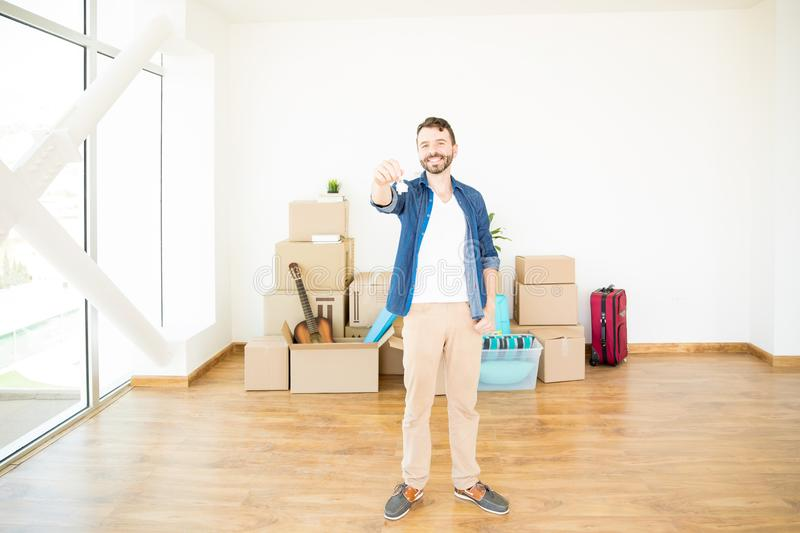 Happy Owner Holding House Keys In New Home stock photo