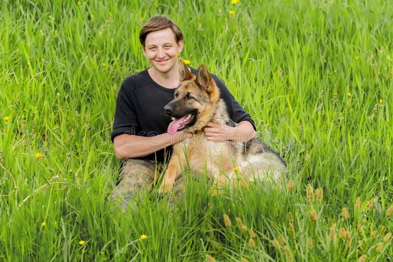 Happy Owner hugs his dog. German shepherd Training stock image