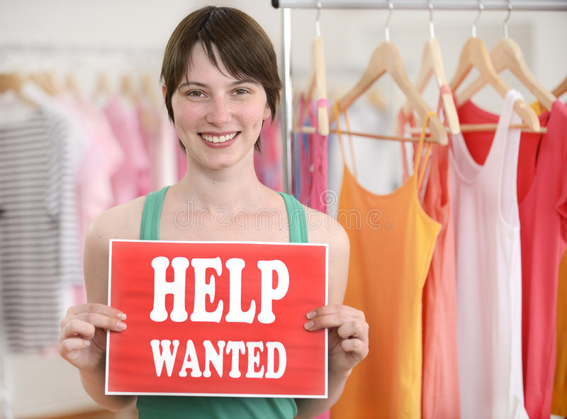 Happy owner of store with help wanted sign. Happy proud owner of store with help wanted sign royalty free stock images