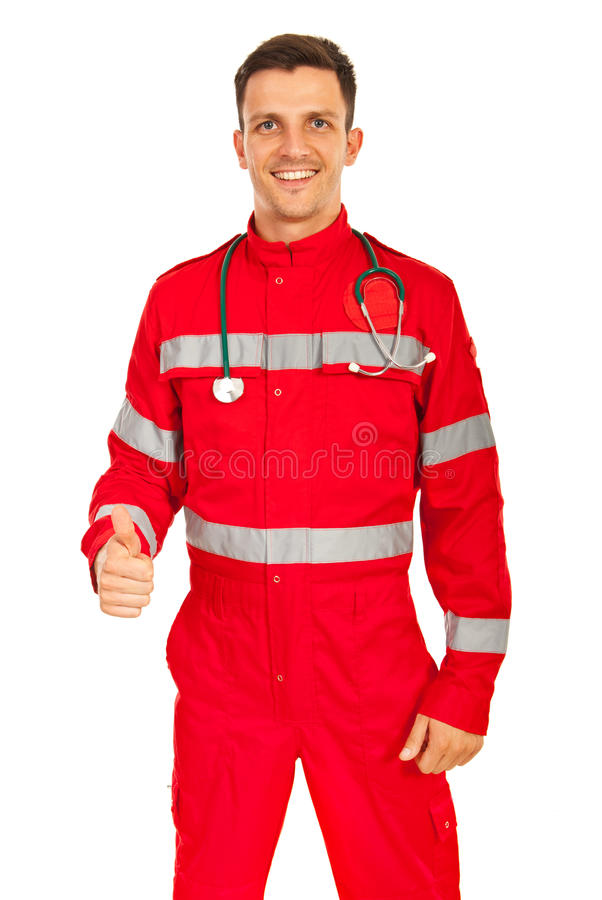 Happy paramedic gives thumbs. Happy paramedic man giving thumb up isolated on white background stock image