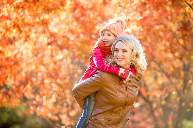 Happy parent and kid family walking together outdoor in fall royalty free stock photos
