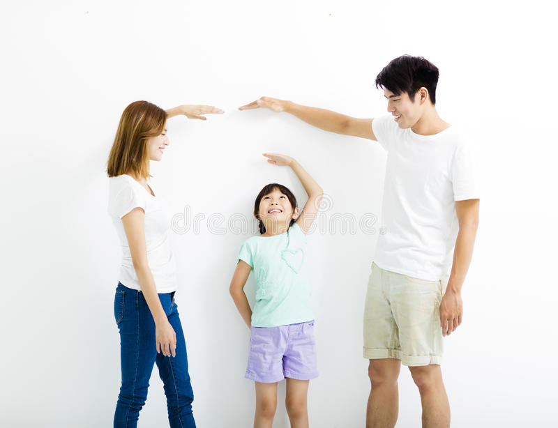 Happy parent measures the growth of daughter stock image