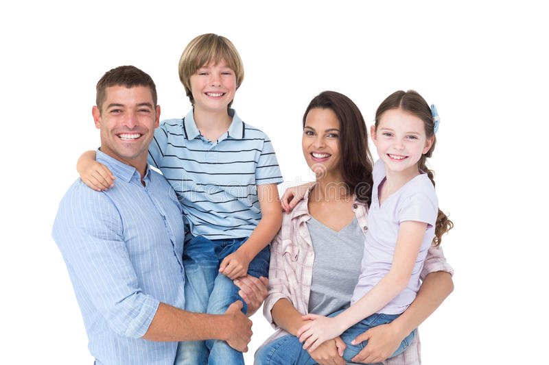 Happy parents carrying children over white background stock photo