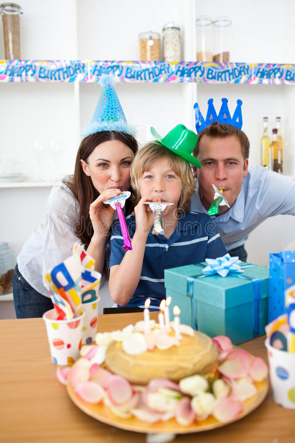 Happy parents celebrating their son's birthday. In the kitchen royalty free stock images