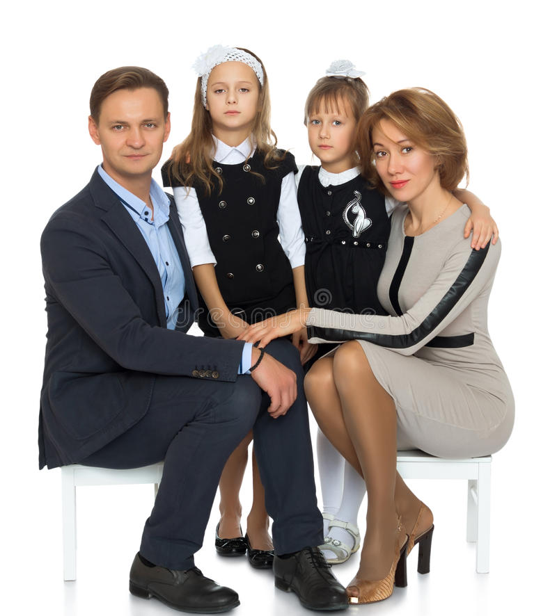 Wedding Poses With Parents: Serious, Elegantly Dressed Schoolgirl Sitting On A Stock