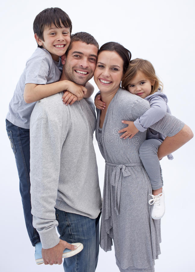 Download Happy Parents Giving Children Piggyback Rides Stock Photo - Image: 11541734