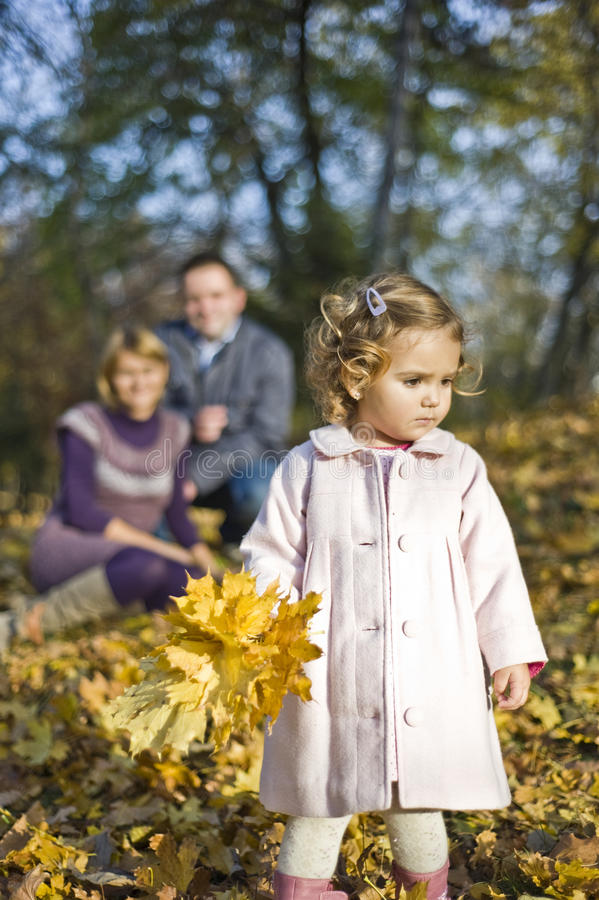 Happy parents and little girl royalty free stock image
