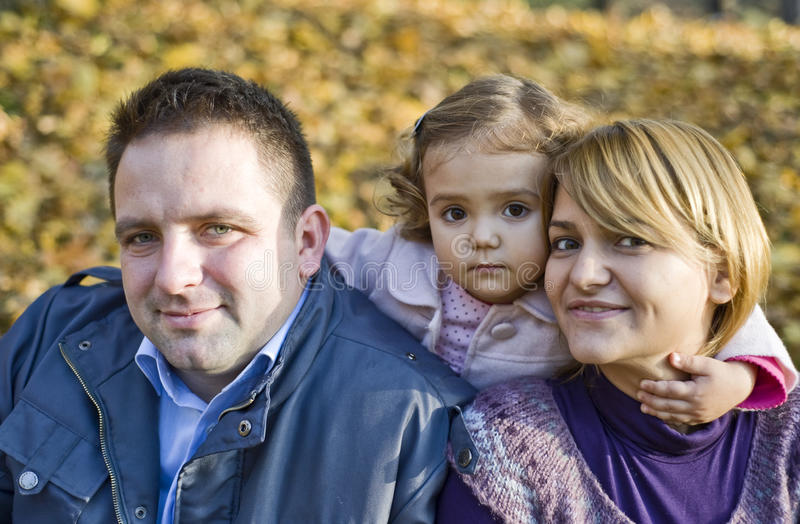 Happy parents and little girl stock photos