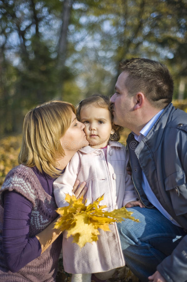 Happy parents and little girl royalty free stock photography