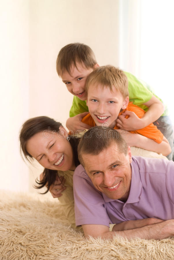 Happy parents with their children stock images
