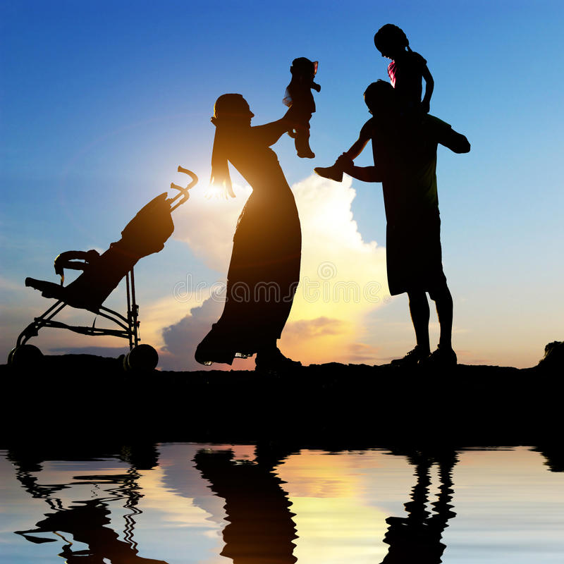 Happy parents with their little children stock image