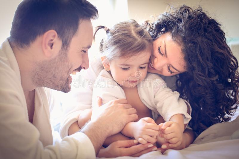 Happy parents with their little girl. Portrait. Family time stock image