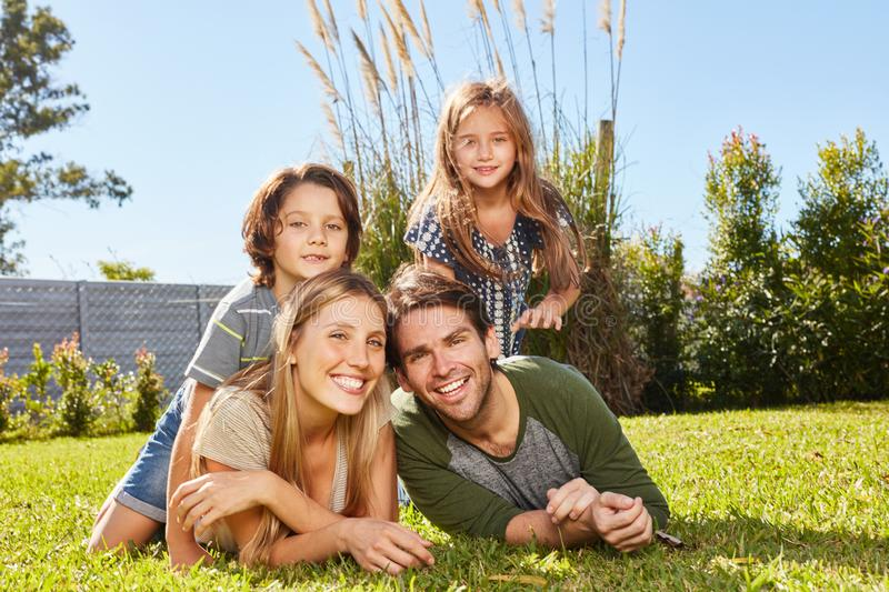 Happy parents and two kids in nature stock image
