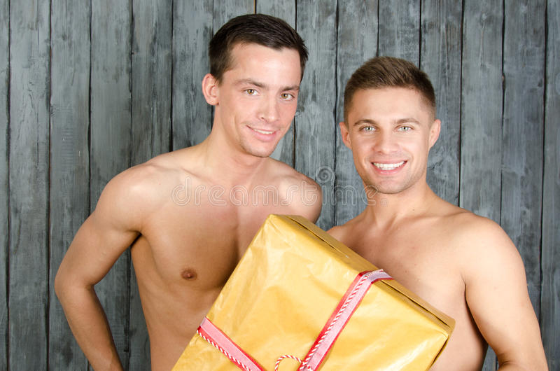 Happy partners and a gift. royalty free stock images