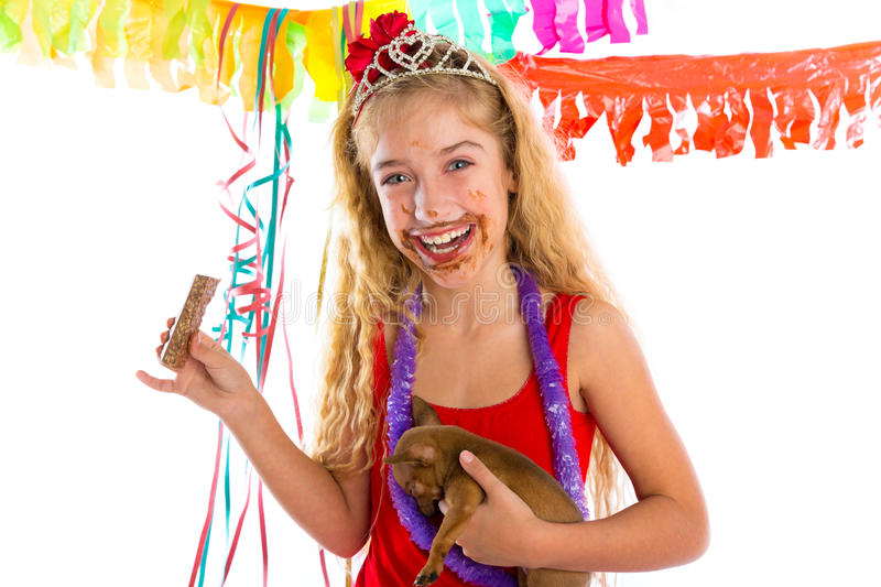 Happy party girl puppy present eating chocolate royalty free stock image