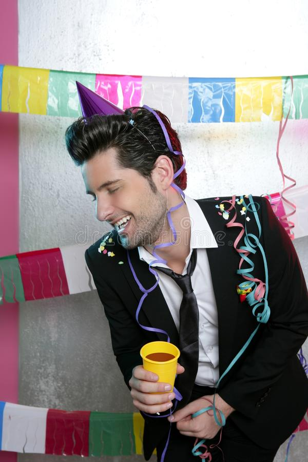 Happy party young man drinking enjoying alone royalty free stock photo