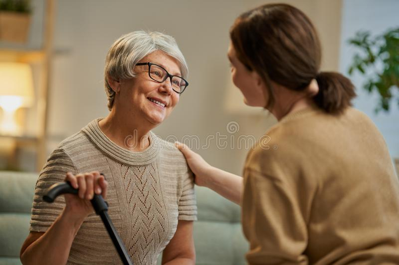 Happy patient and caregiver stock images