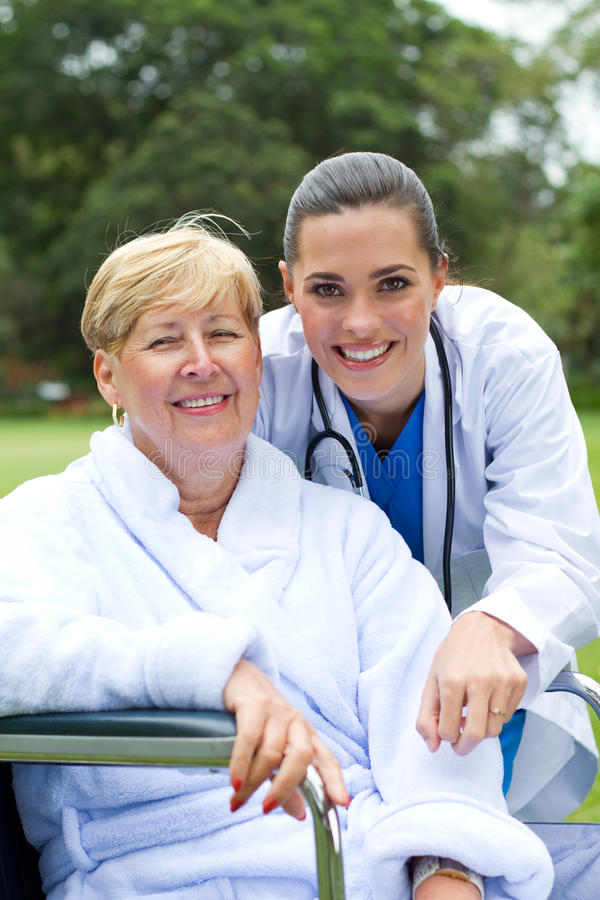 Happy Patient And Doctor Stock Images